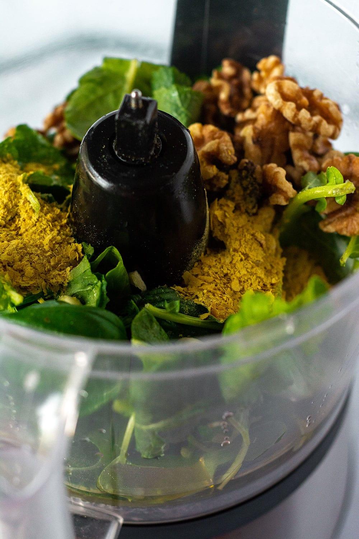vegan kale pesto ingredients in the food processor