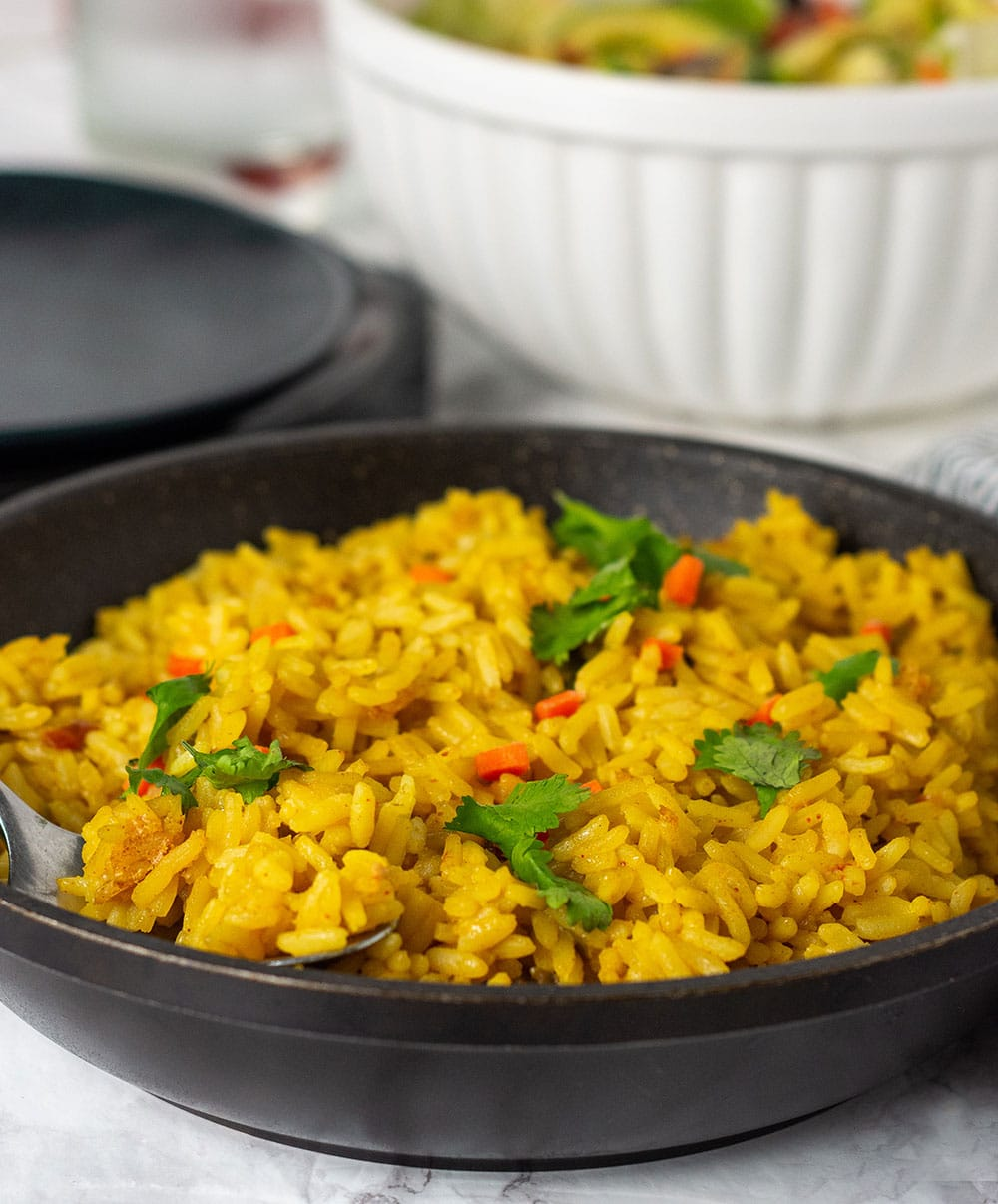 Turmeric coconut rice made with seasoned coconut milk, flavorful and easy to prepare