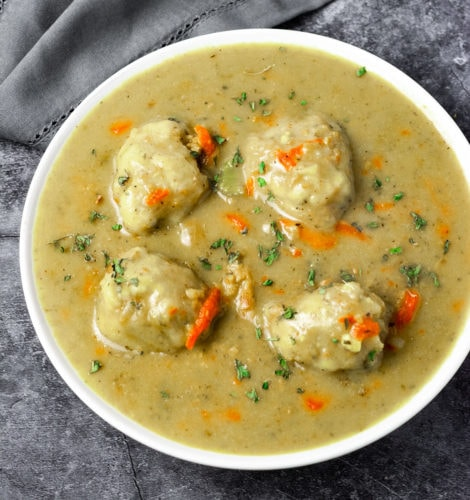 Overlay Vegan chicken and dumplings over showing 4 gluten-free vegan dumplings in a white bowl on a grey background