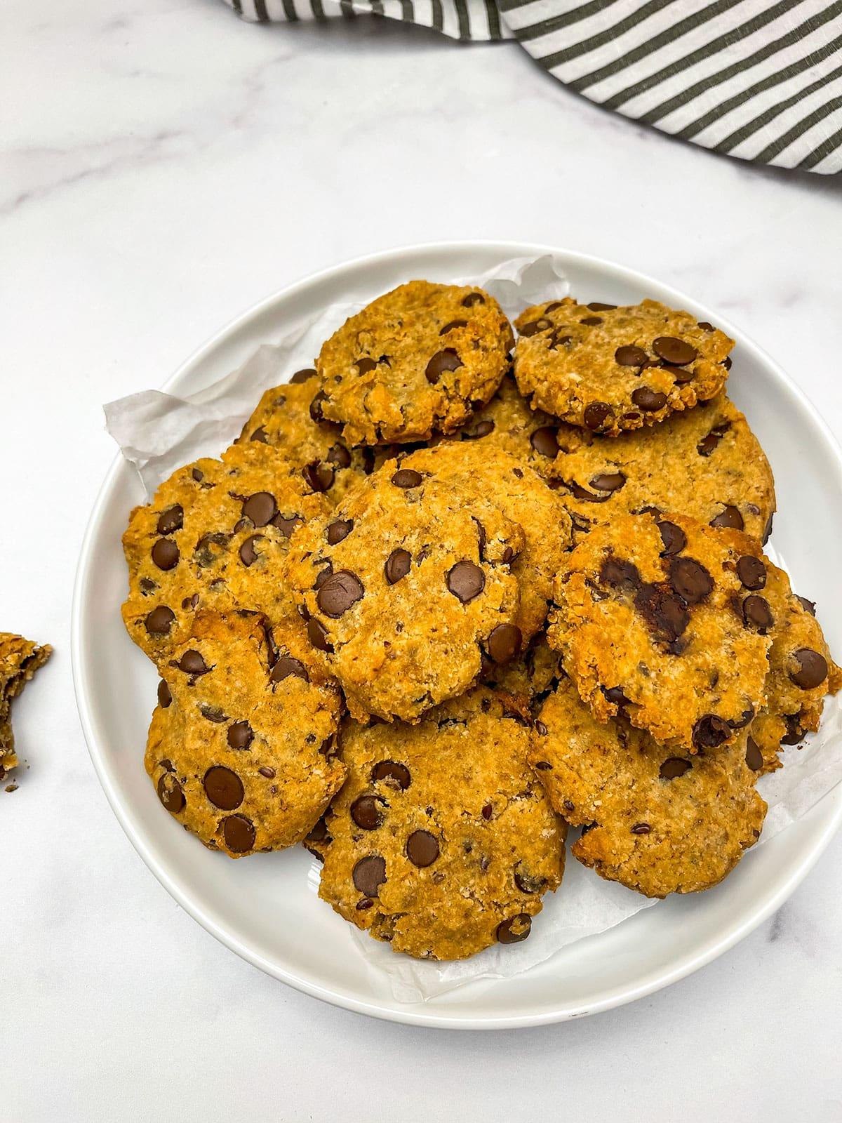 vegan gluten free chocolate chips cookies on a white plate