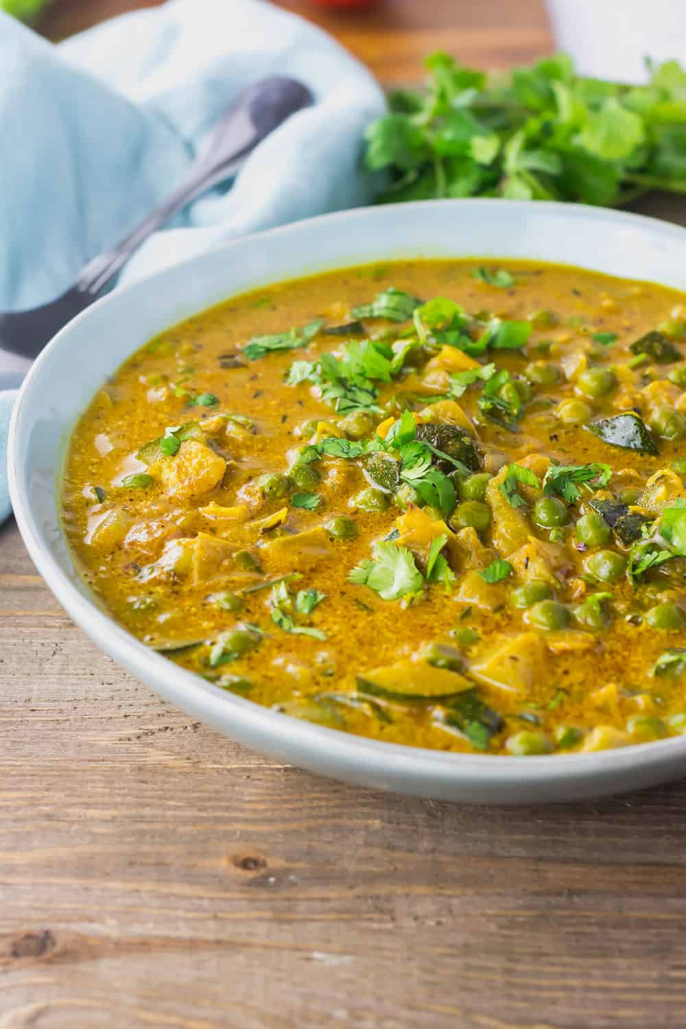 Zucchini and Peas Curry in a bowl