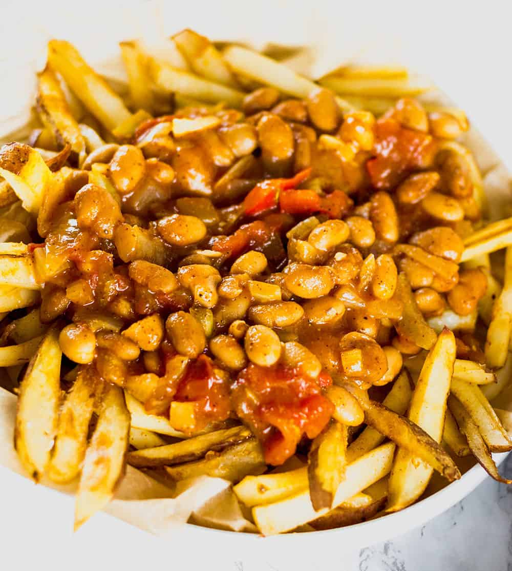 Vegan Pinto Bean Chili Cheese Fries- Fries topped with chili