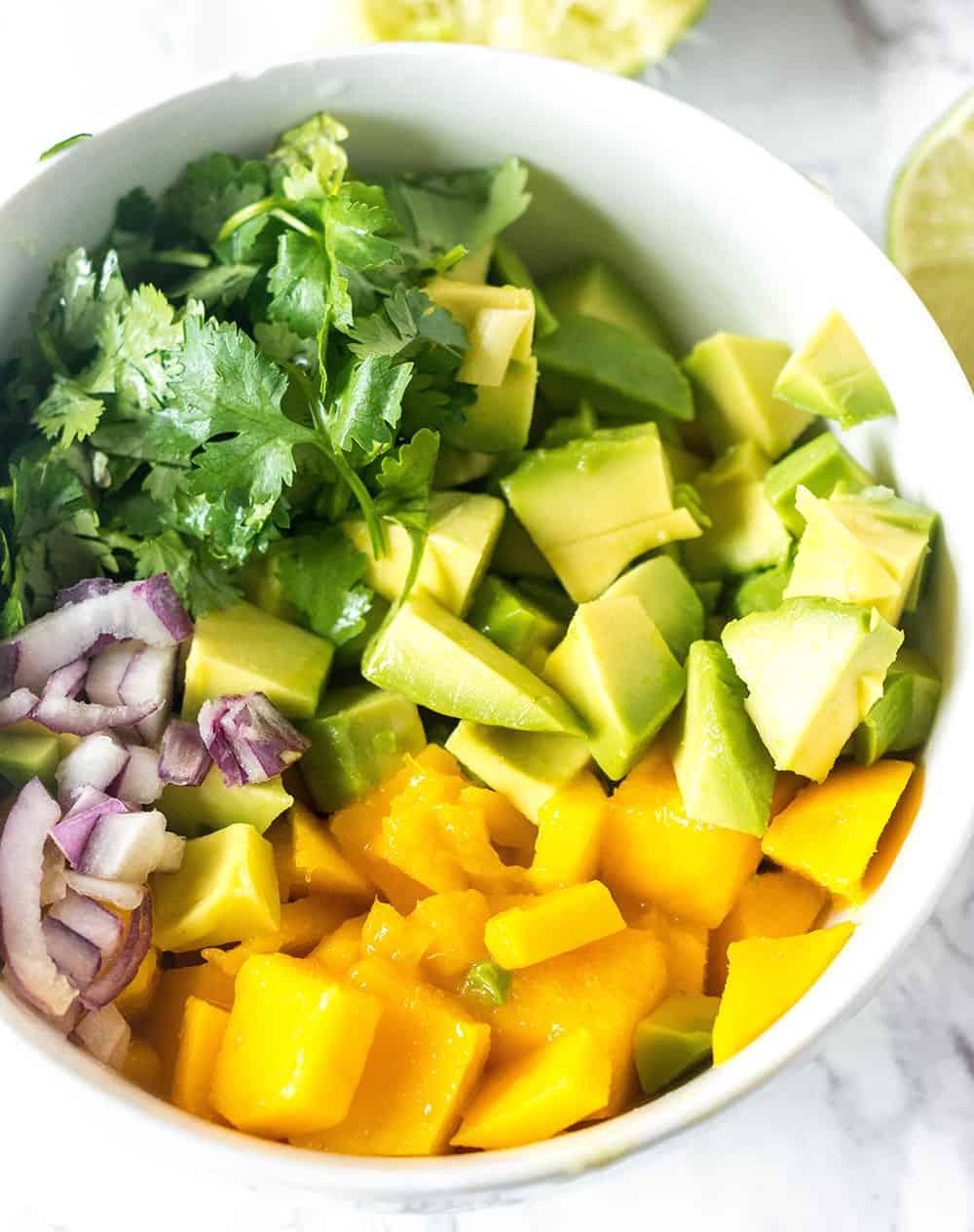 Mango Avocado Salsa Ingredients in a white bowl