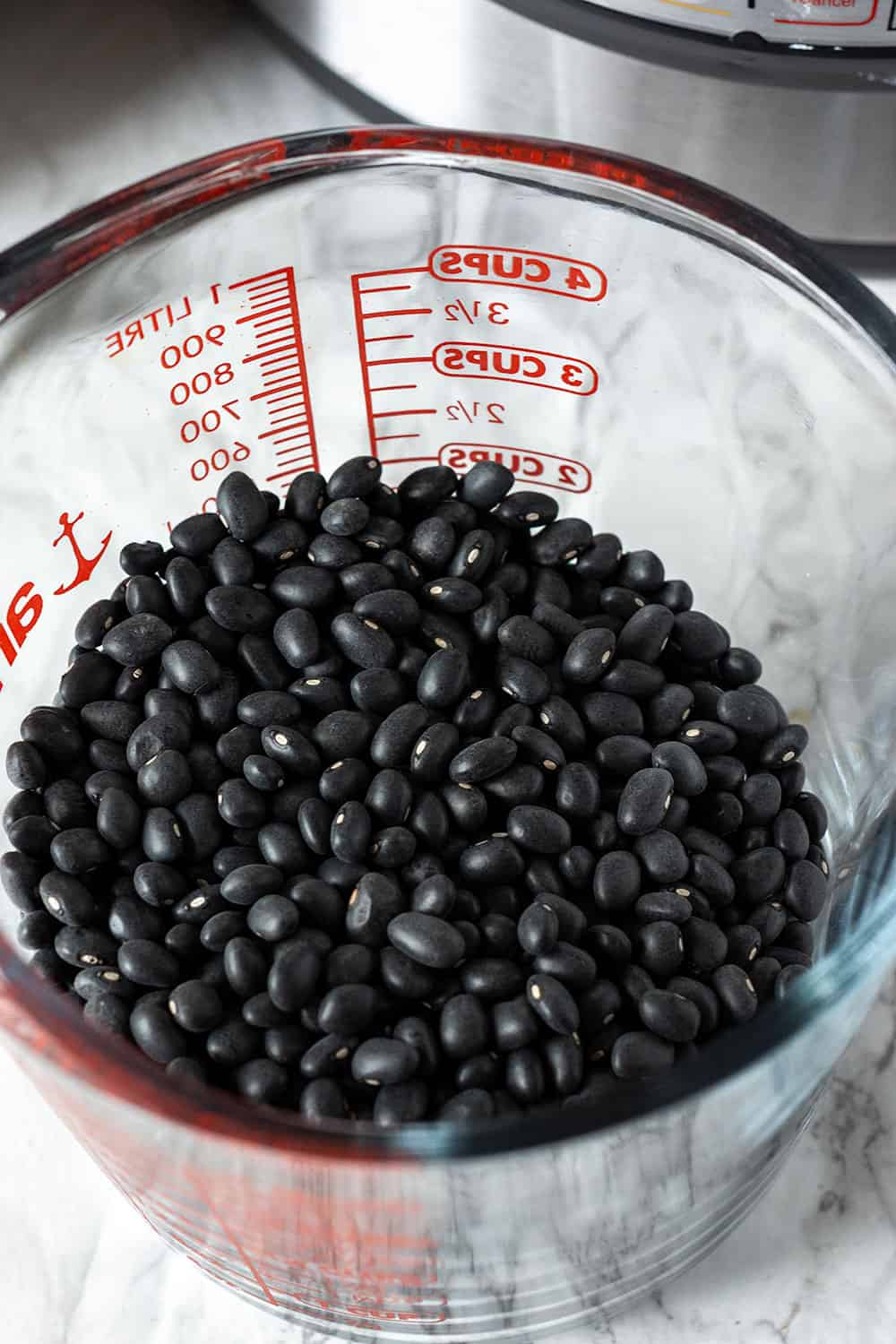 Instant Pot Black Beans in a measuring cup