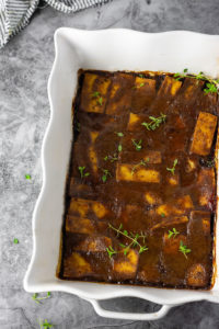 Overlay jerk tofu in a white pan