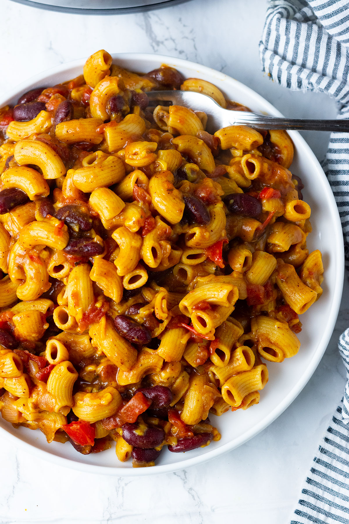 Instant Pot Vegan Chili Mac And Cheese overlay in white plate