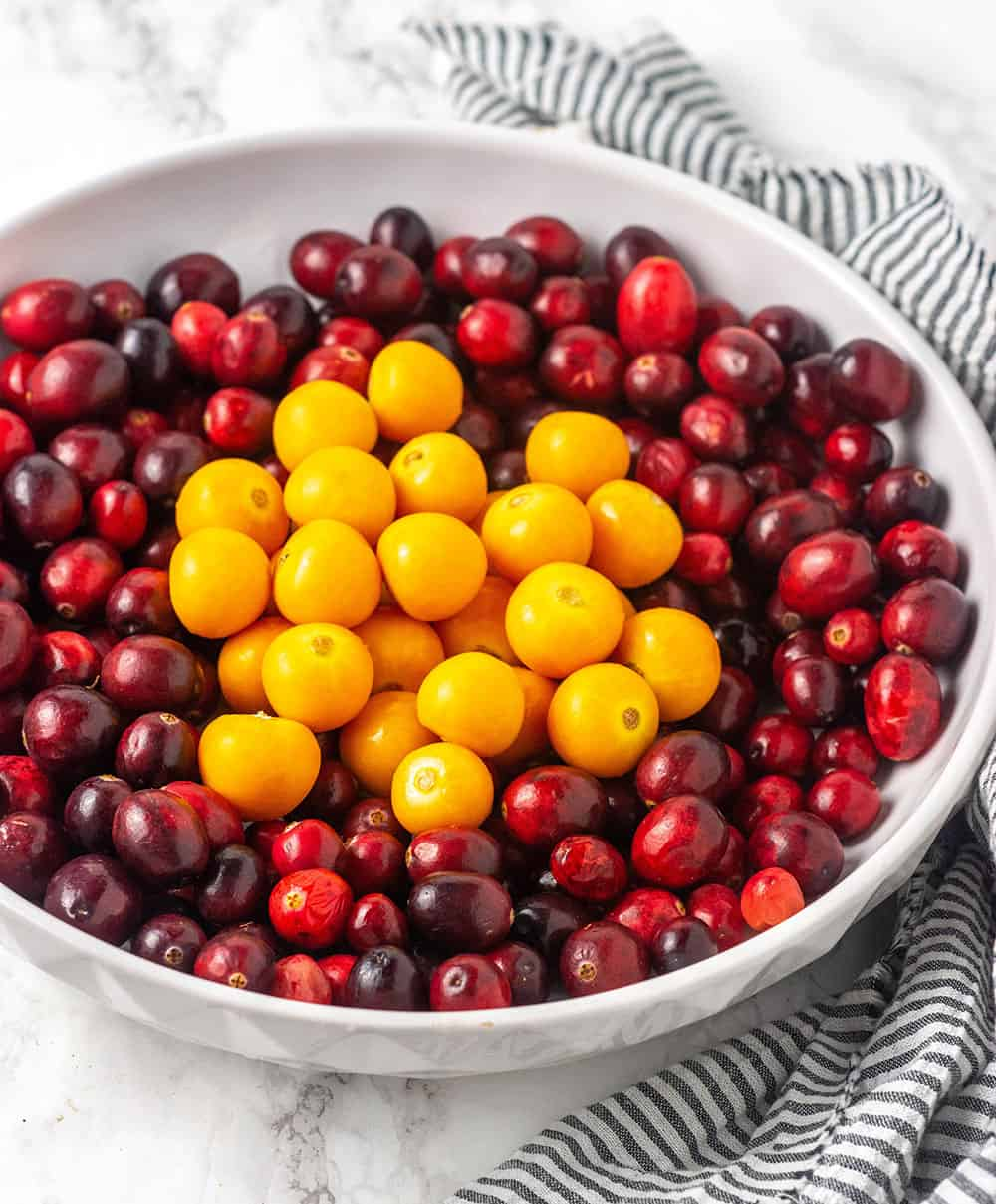 Cranberry And Ground Cherries In A White Bowl