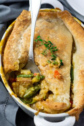 Overlay, gluten free vegan pot pie recipe with jackfruit, carrots, potato, celery in a creamy sauce