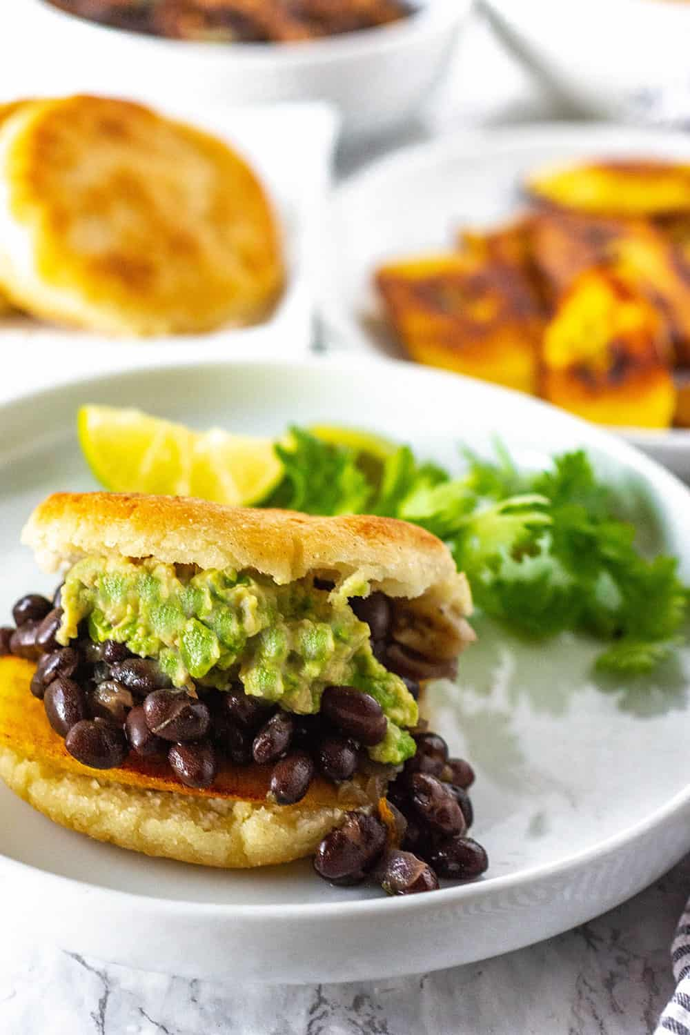 How To Make Arepas With Black Beans Plantains And Guacamole
