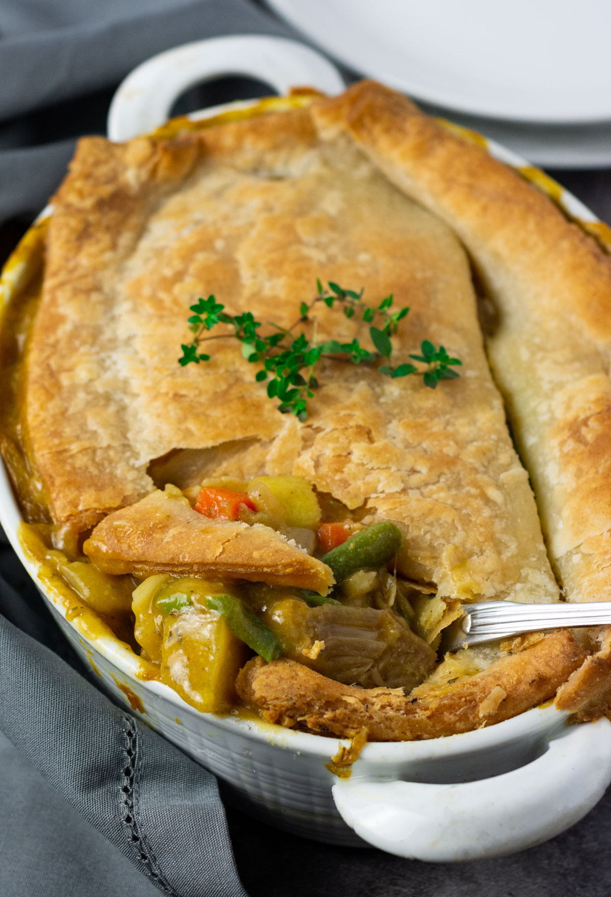 Overlay, gluten free vegan pot pie recipe with jackfruit, carrots, potato, celery in a creamy sauce