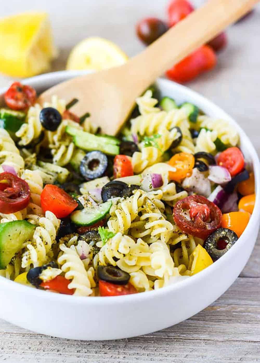 24 Vegan Pasta Salads Italian Pasta Salad with pasta, veggies in a hite bowl