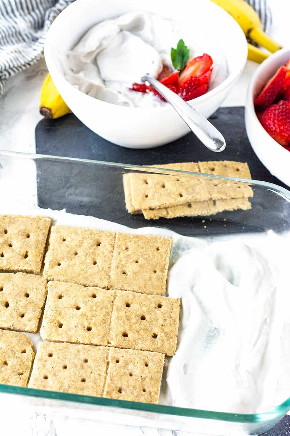 Strawberry Icebox cake with graham crackers and coconut whipped cream