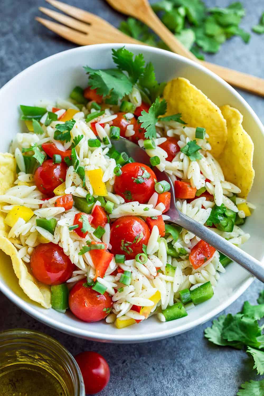 Healthy Orzo Salad with orzo, tomatoes, artichoke