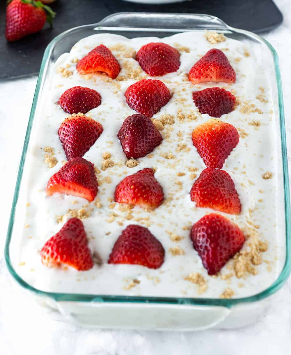 Strawberry Icebox cake vegan gluten-free in a glass dish topped with strawberries