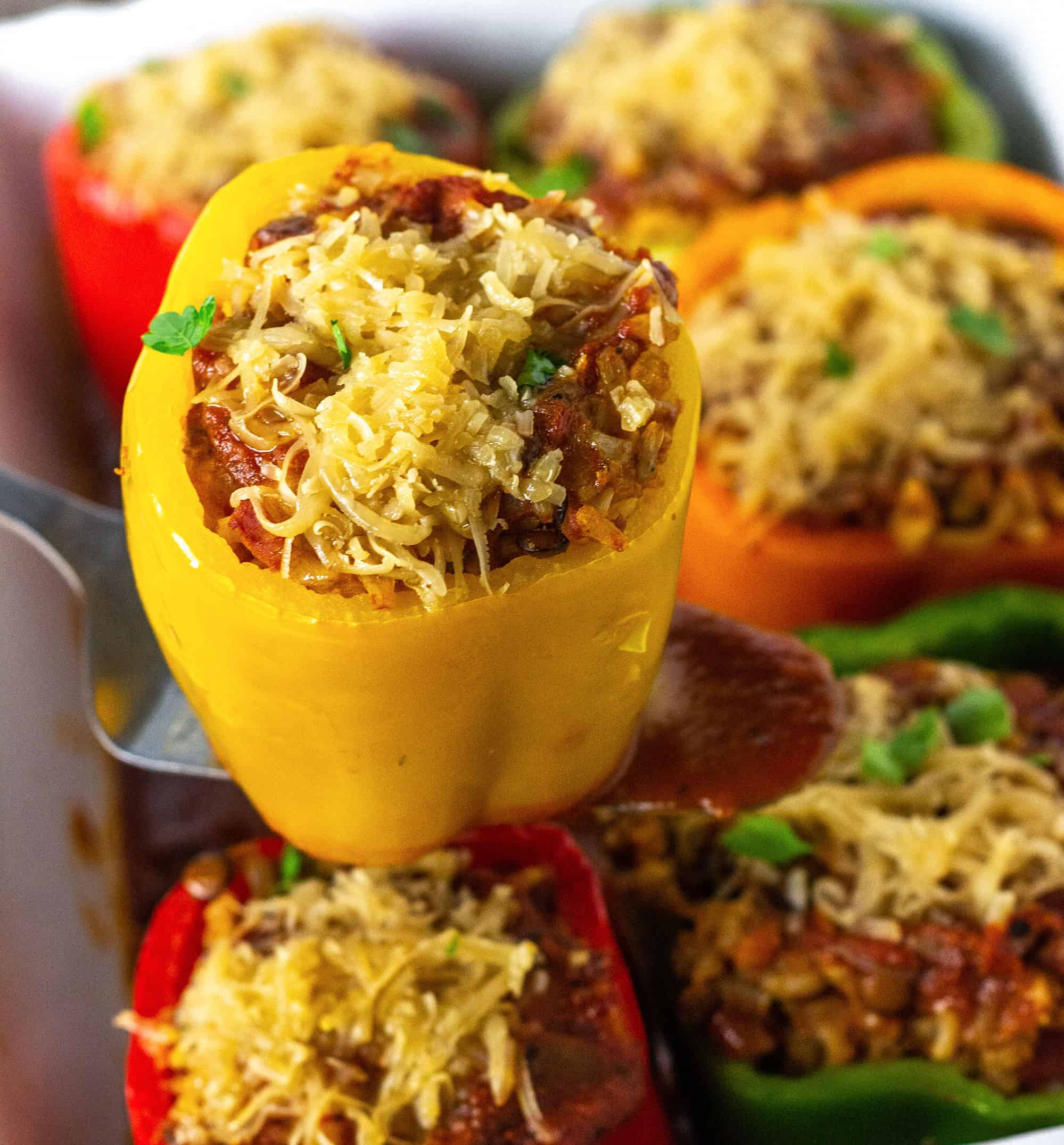 Easy Vegan Stuffed bell peppers close view showing yellow stuffed bell pepper