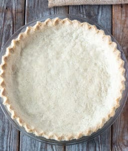 Almond Flour Pie crust with only 4 ingredients, overhead shot on a brown background