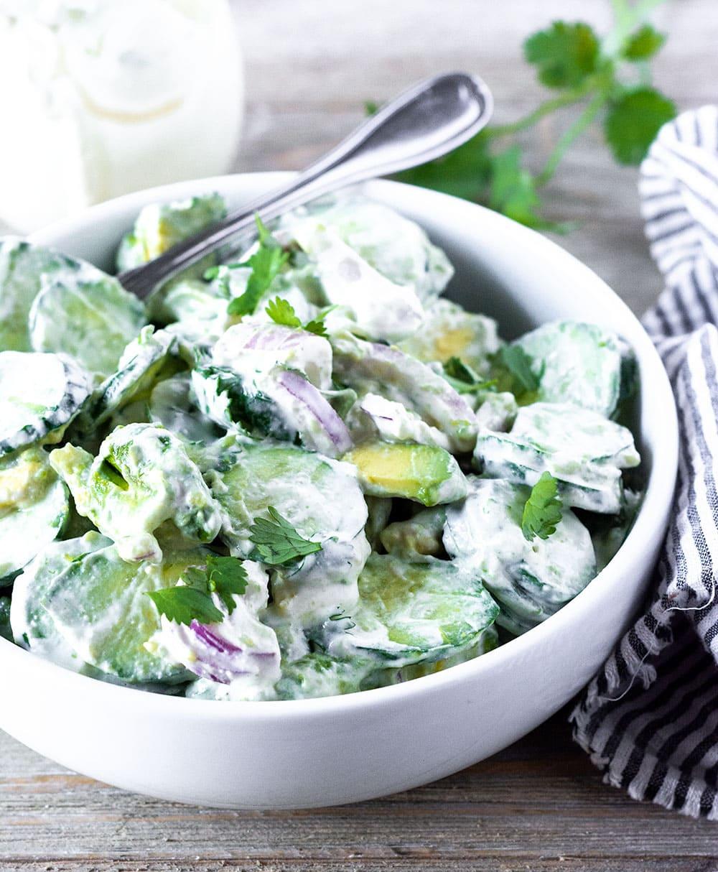 Cucumber avocado salad in a bowl,