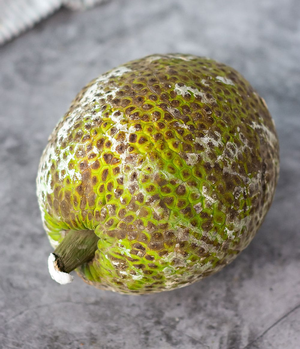 Green Breadfruit for rundown on a marble background