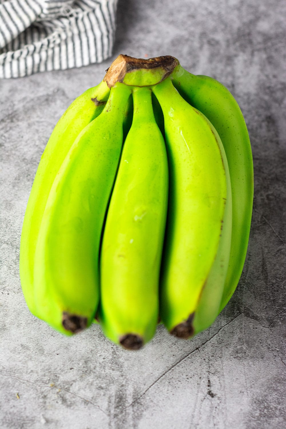 Green banana on a grey marbled background