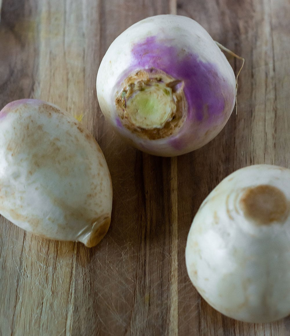 Turnips on cutting board for turnip curry