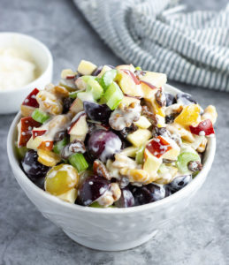 vegan waldorf salad, chopped apple, celery, walnut, raisin, red and green grapes tossed with a waldorf dressing
