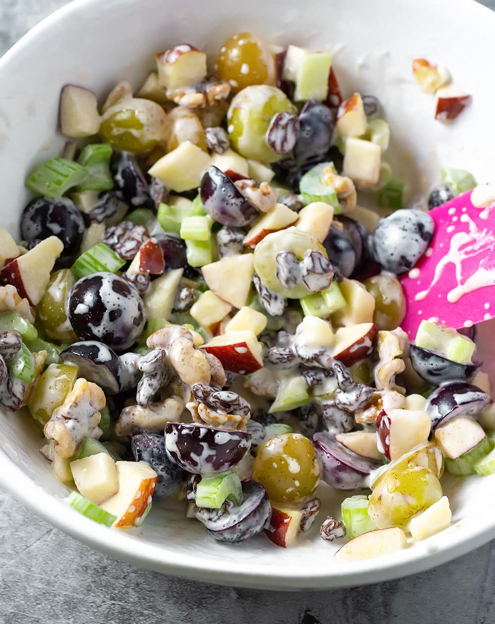 waldorf salad in a white bowl