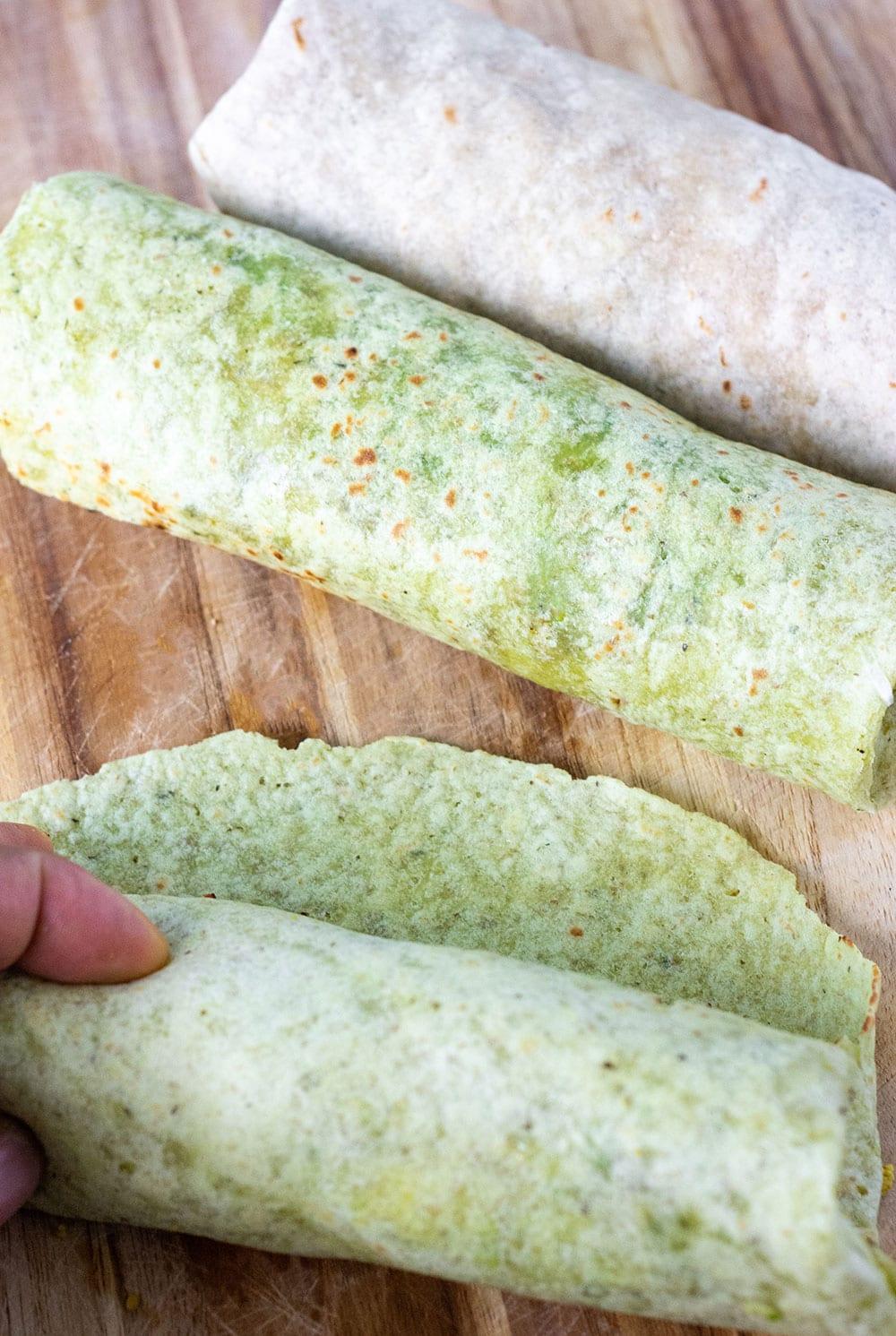 Vegan breakfast burritos being wrapped