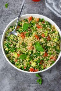 Overlay quinoa tabouli salad with pepper, onion, garlic, parsley, mint