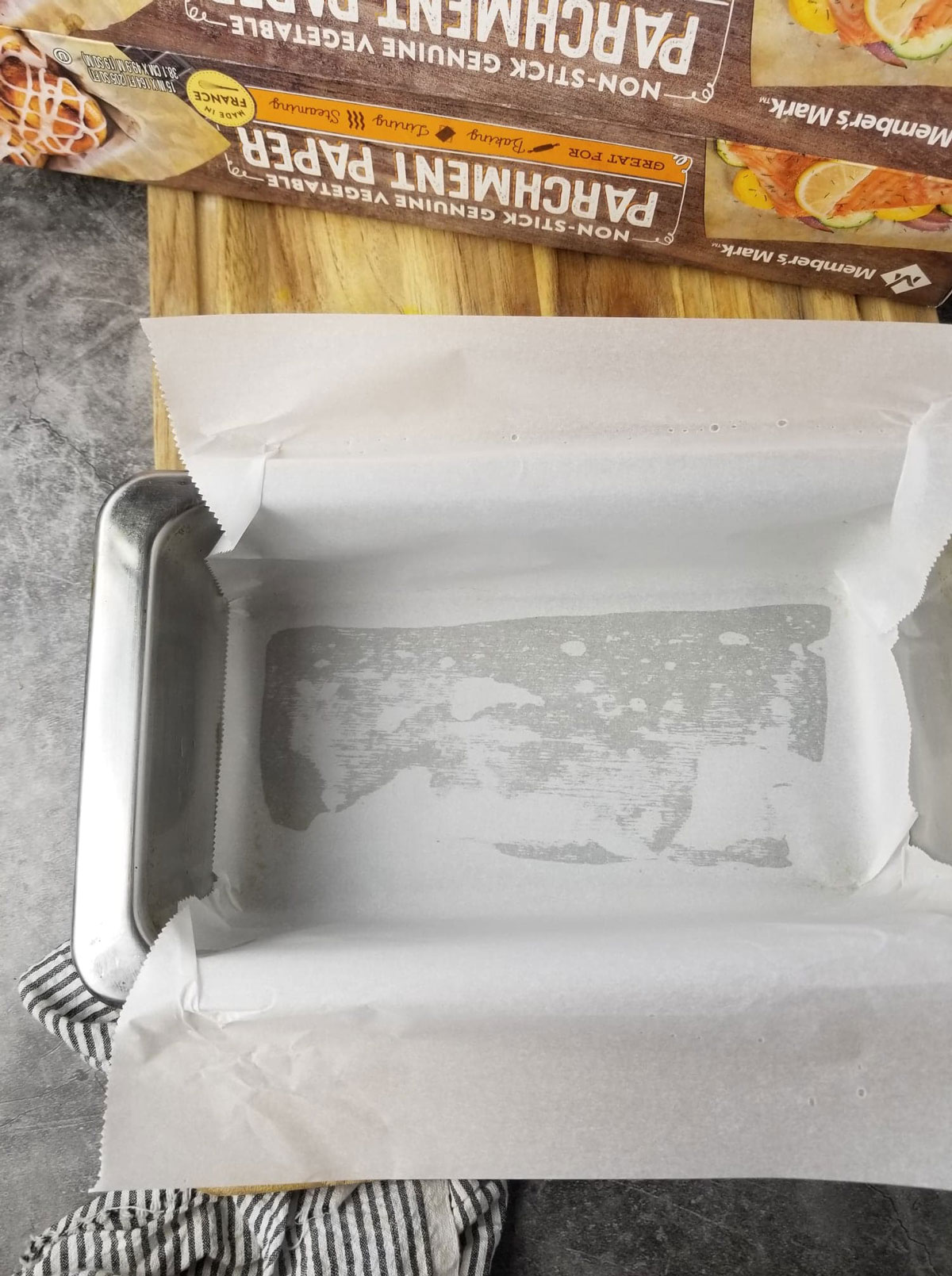 baking pan lined with parchment paper for making vegan pound cake