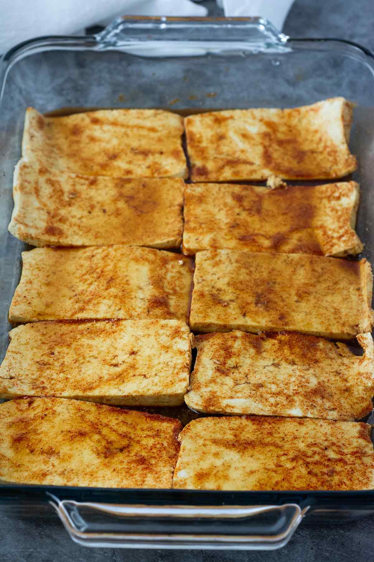 marinated tofu bacon in a glass baking dish
