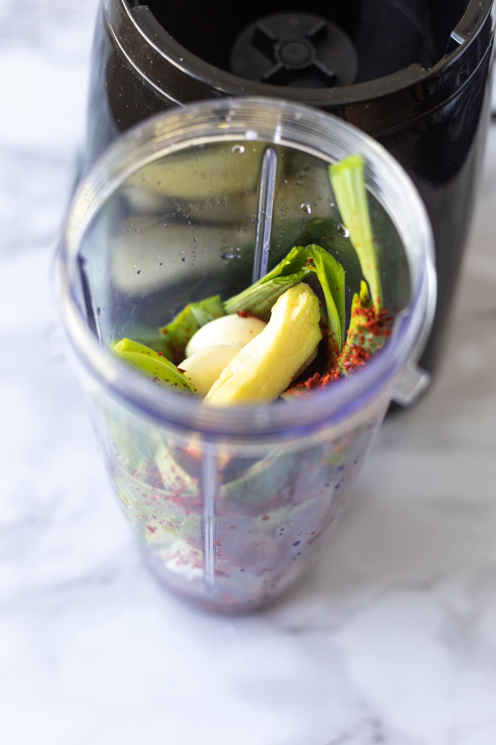 Making kimchi paste in blender with ginger, green onion, garlic, pepper