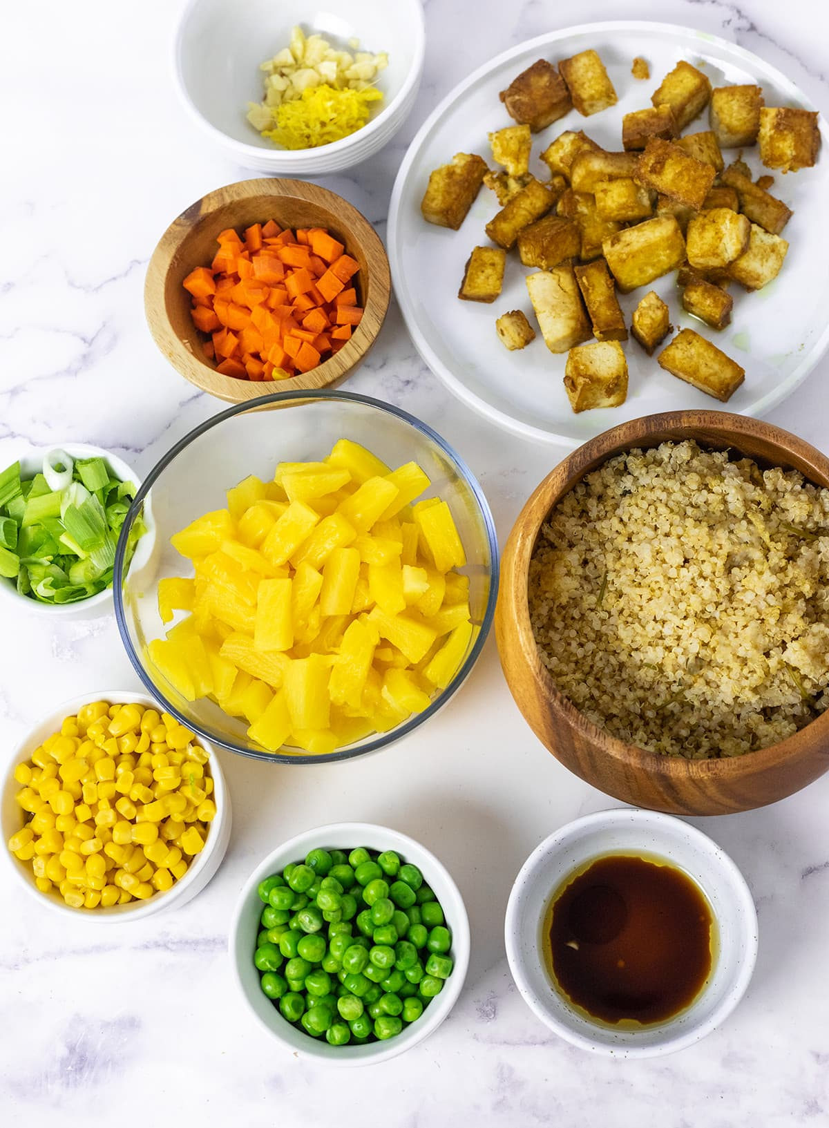 Pineapple Fried Quinoa ingredients on a white background in containers