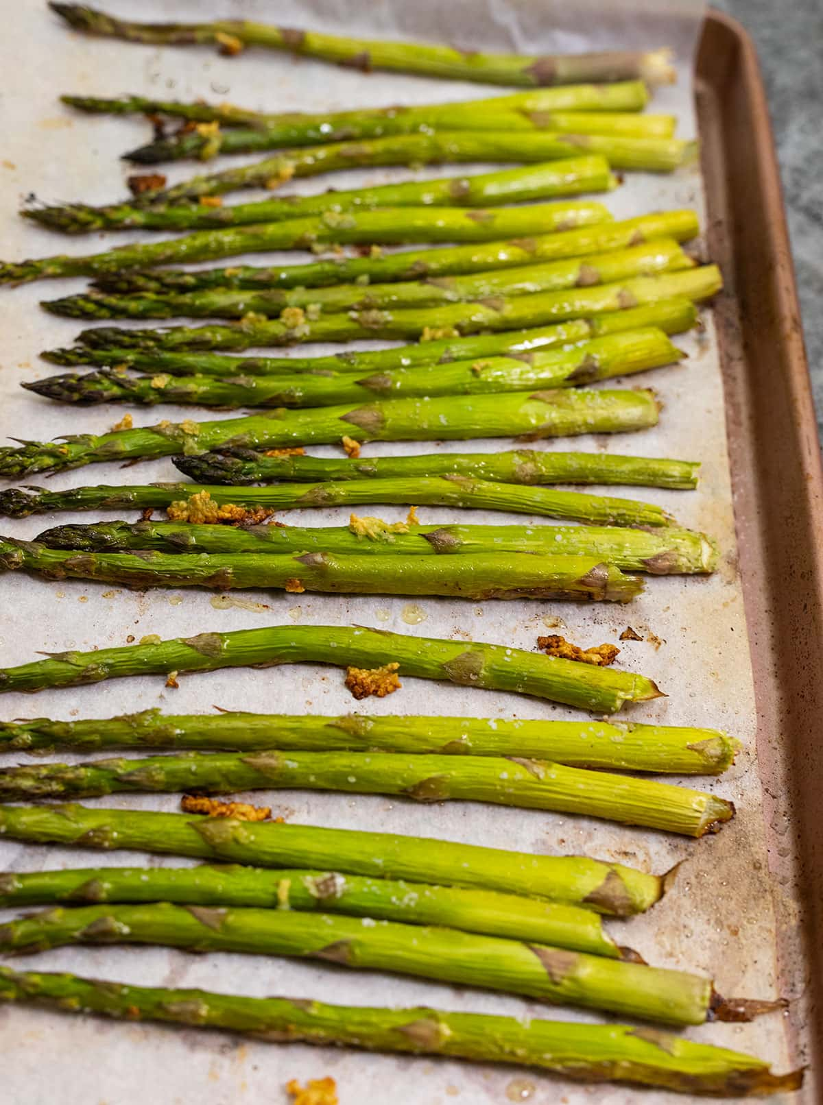 Easy roasted asparagus on a baking sheet lined with parchment paper