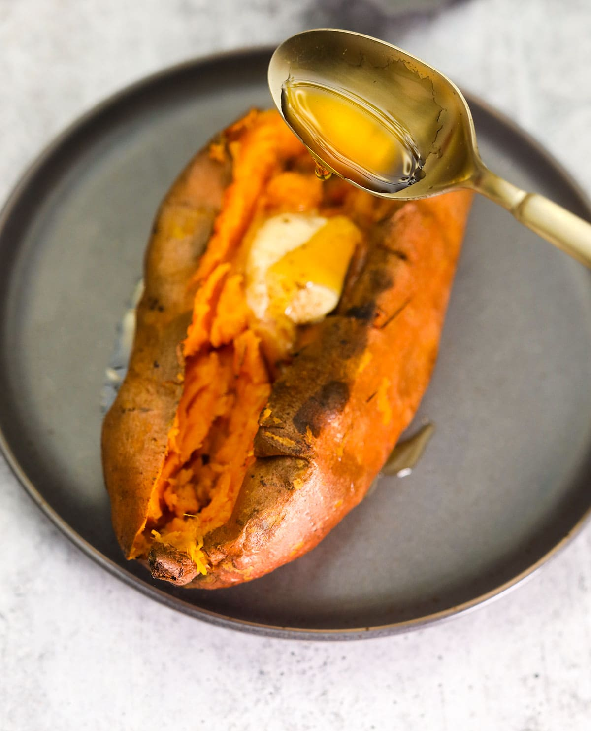 baked sweet potato with maple drizzling