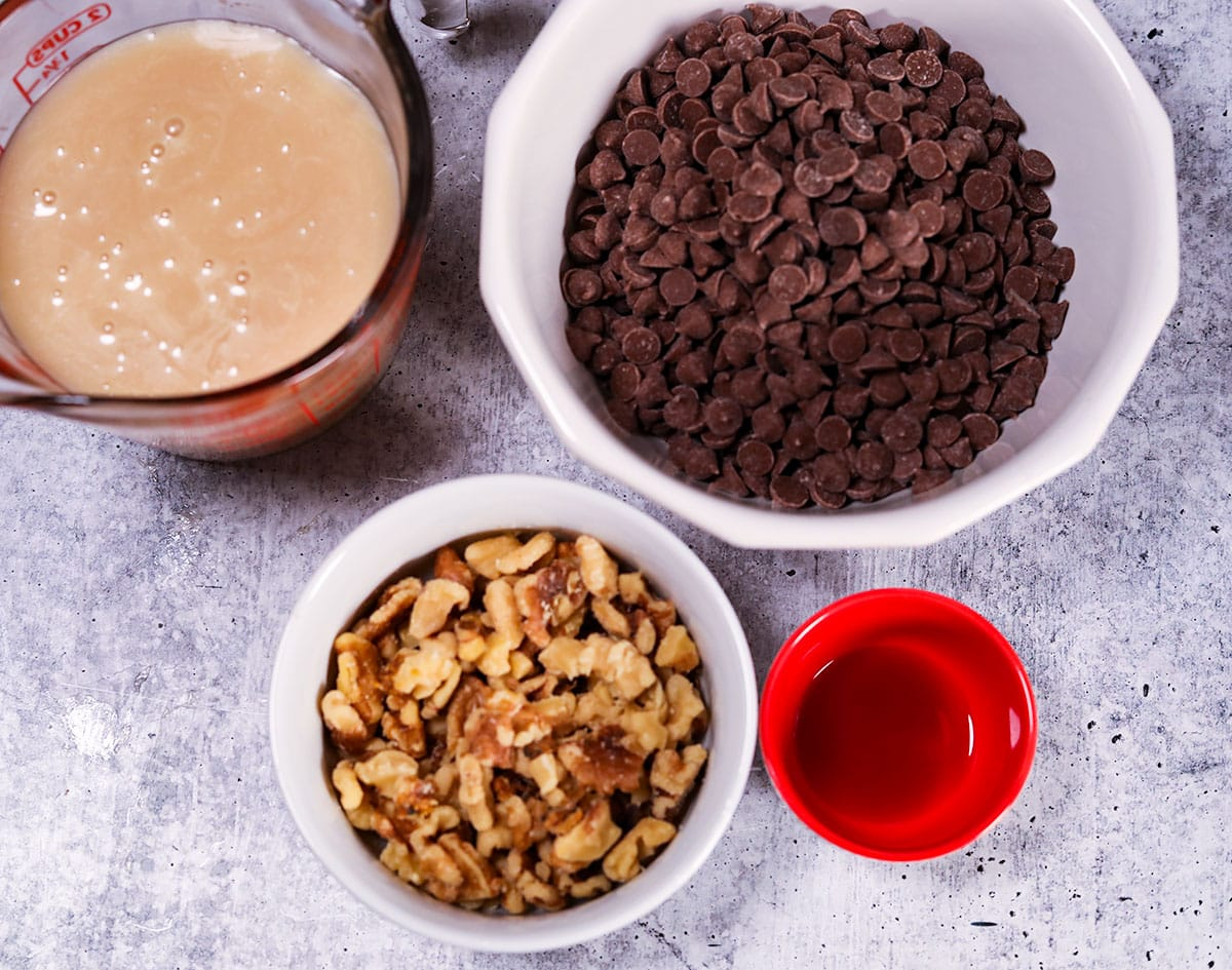 ingredient for vegan fudge in bowls on a white background
