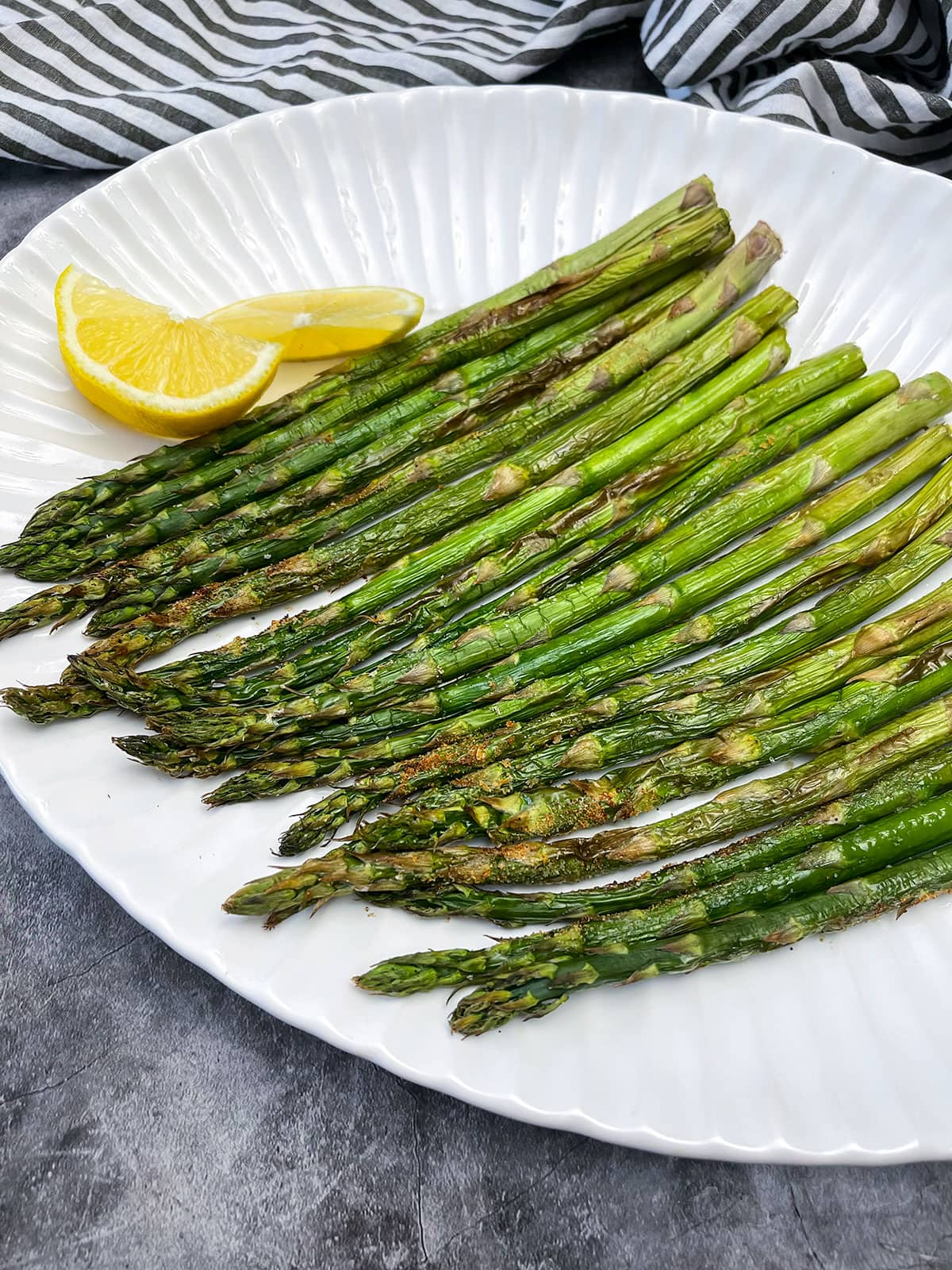 asparagus roasted in the air fryer on a white platter