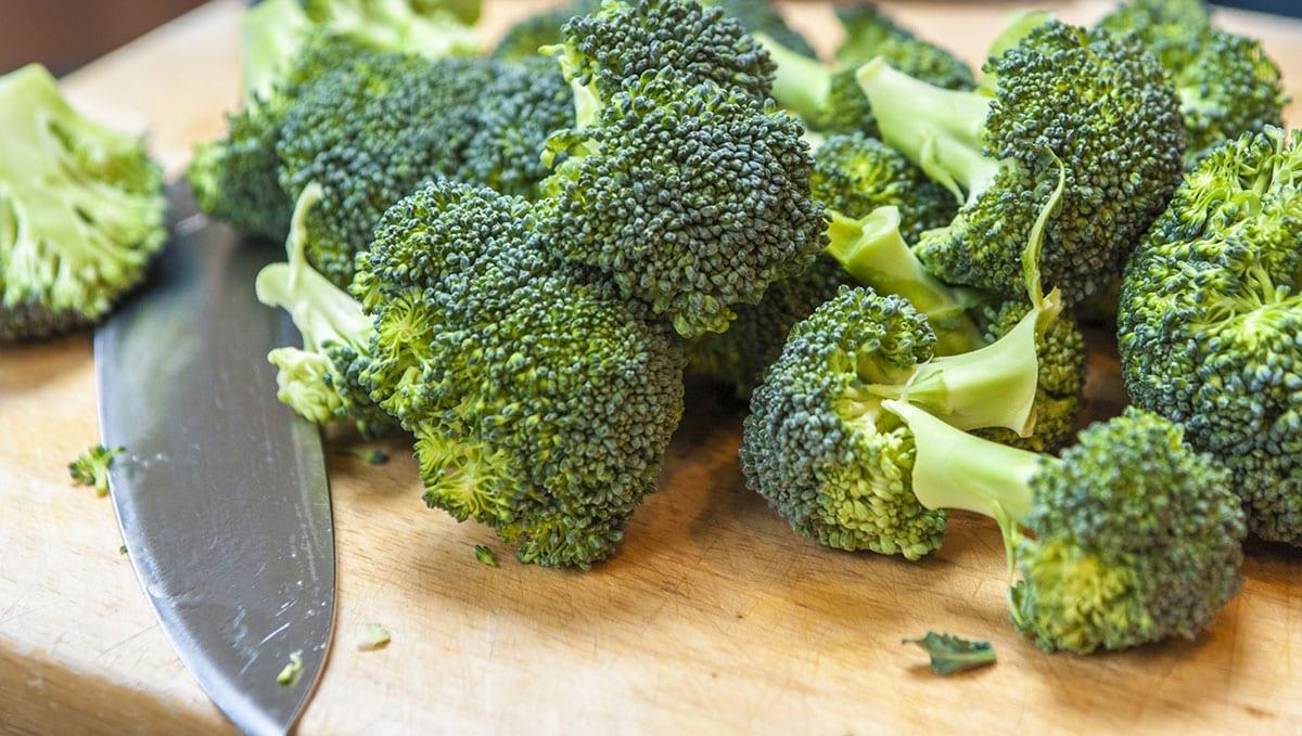 broccoli florets on cutting board