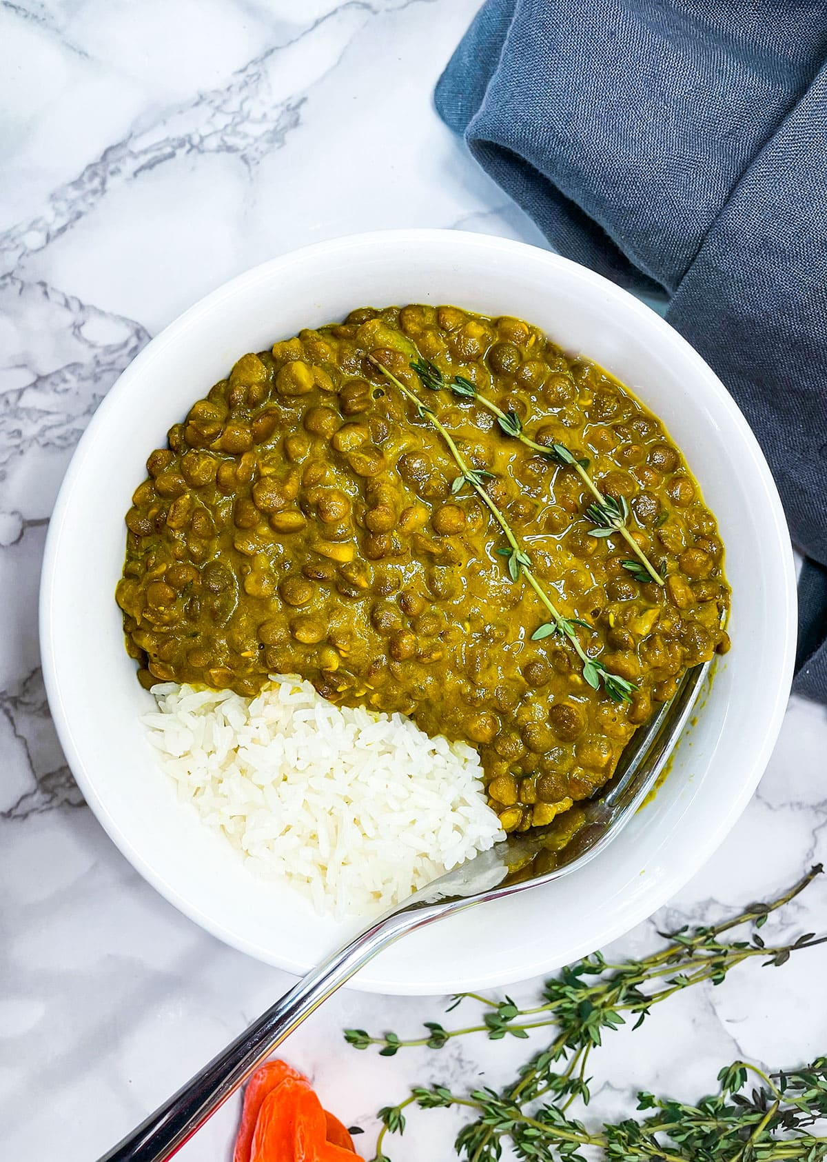 vegan curry lentil in a white plate on a white background