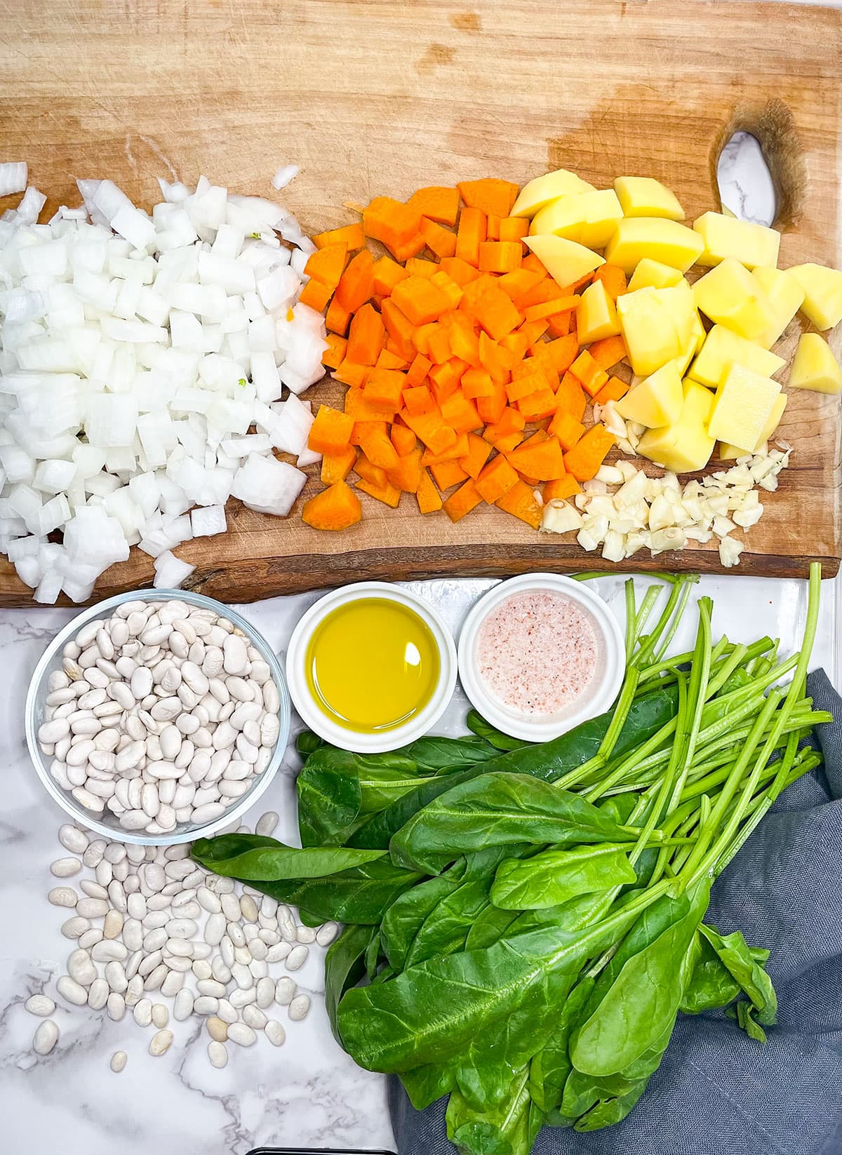 ingredients for instant pot white bean soup on a wooden background