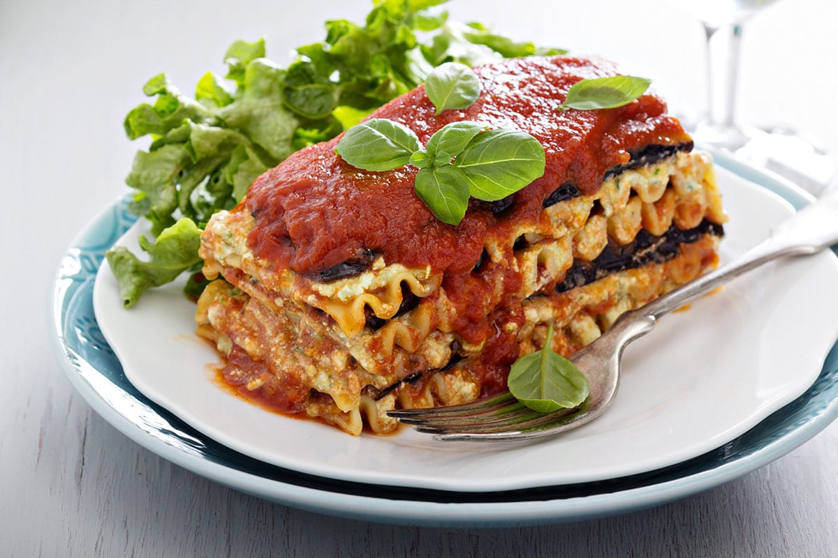 Plant based lasagna on a white plate