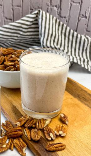 pecan milk in glass jar on cutting board