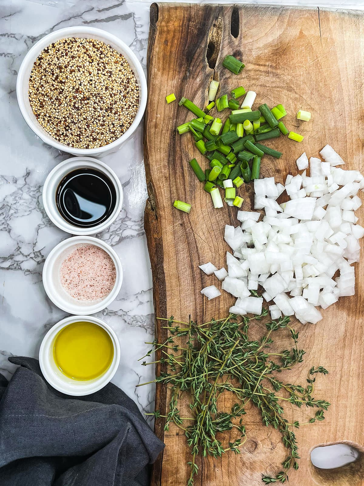 quinoa ingredients on a white background and wooden cutting board