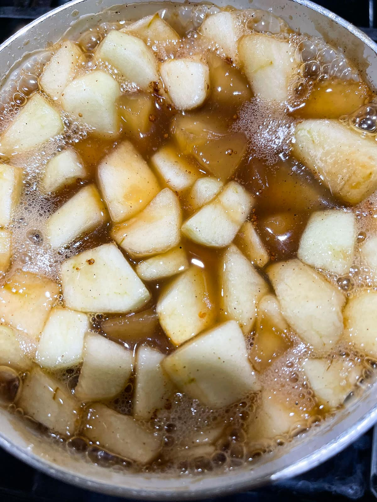 apple pie filling cooking in the pot