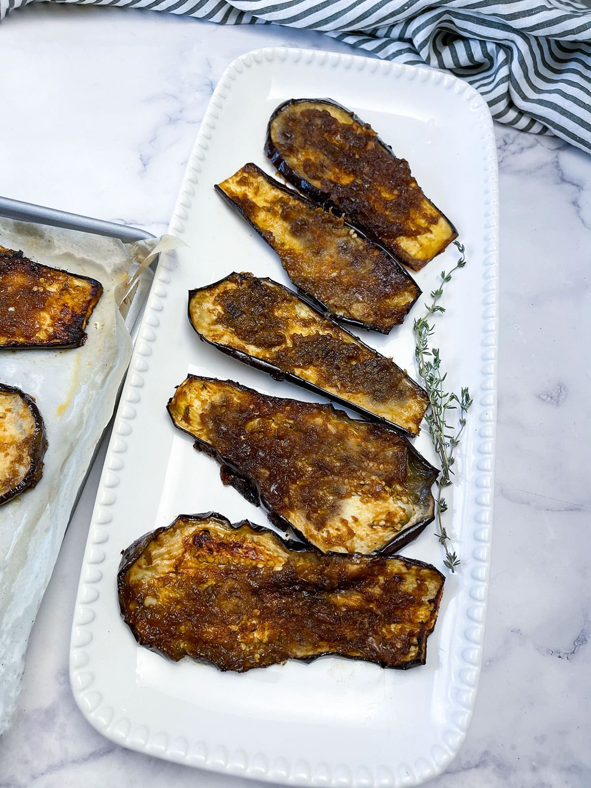 broiled eggplant on a platter