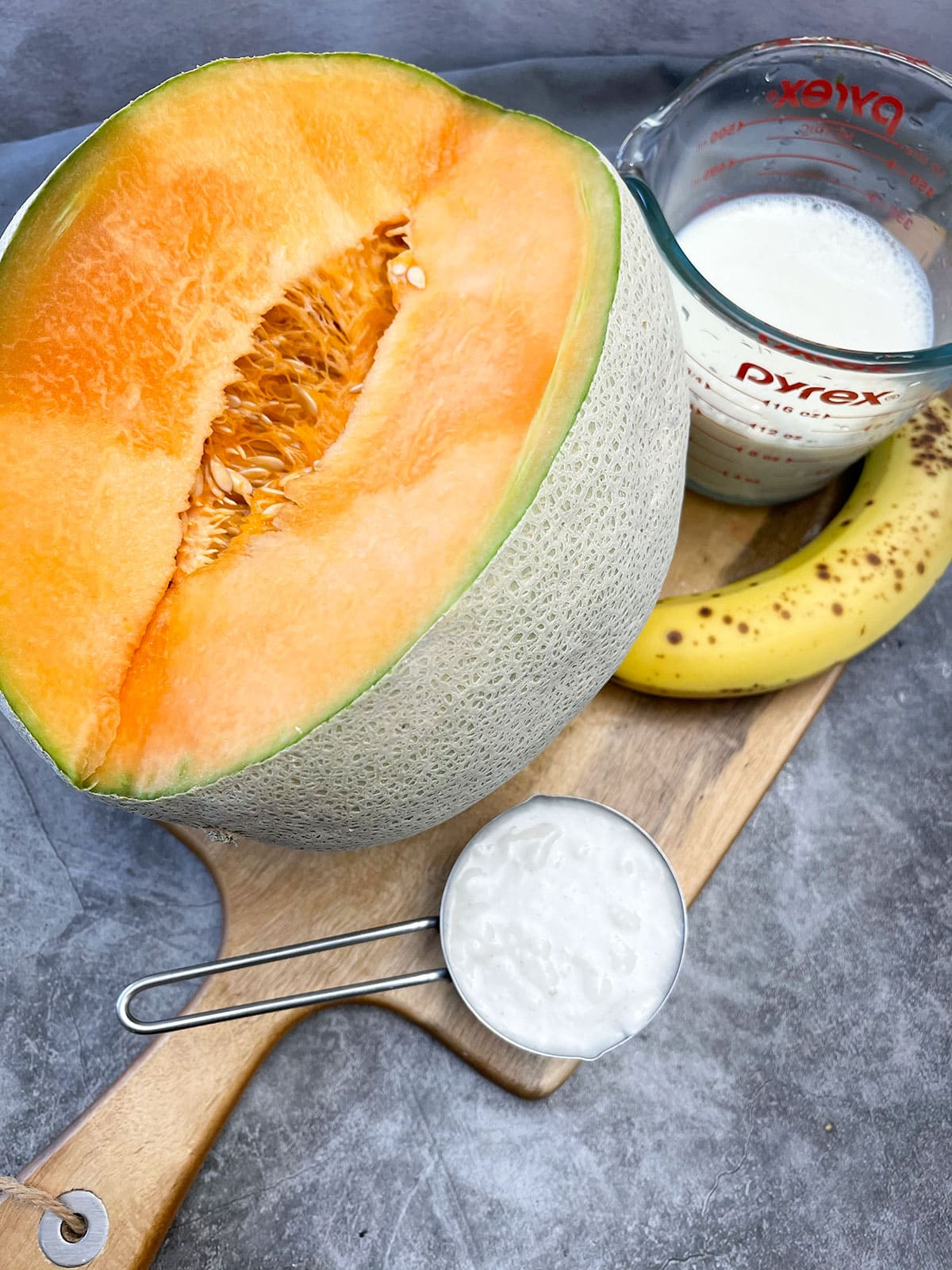 cantaloupe smoothie ingredients on cutting board