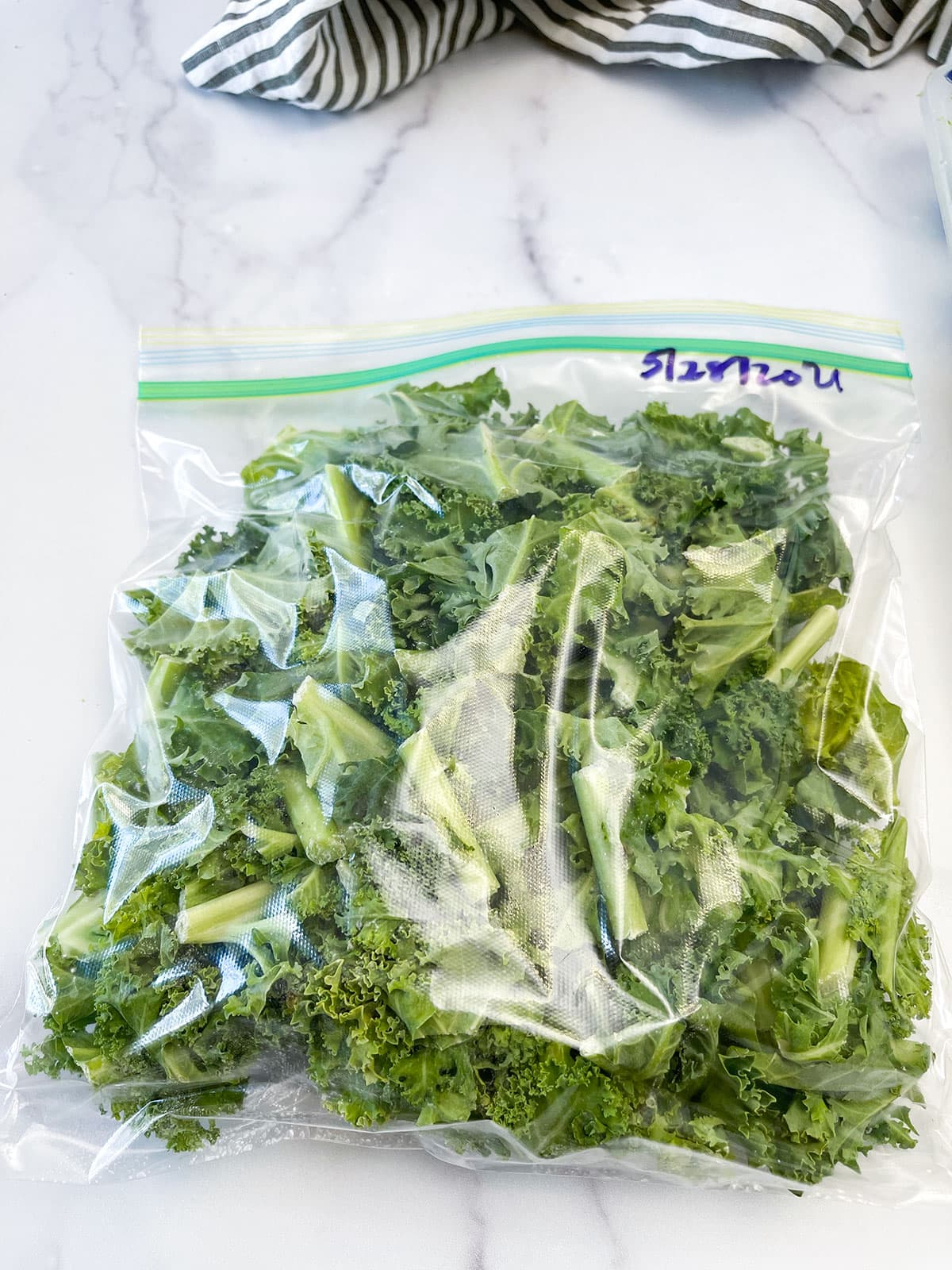 chopped kale in bag on white background