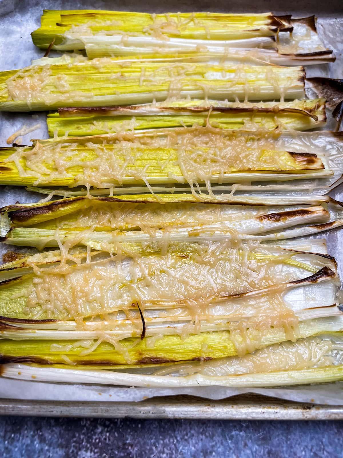roasted leeks in baking sheet, close view