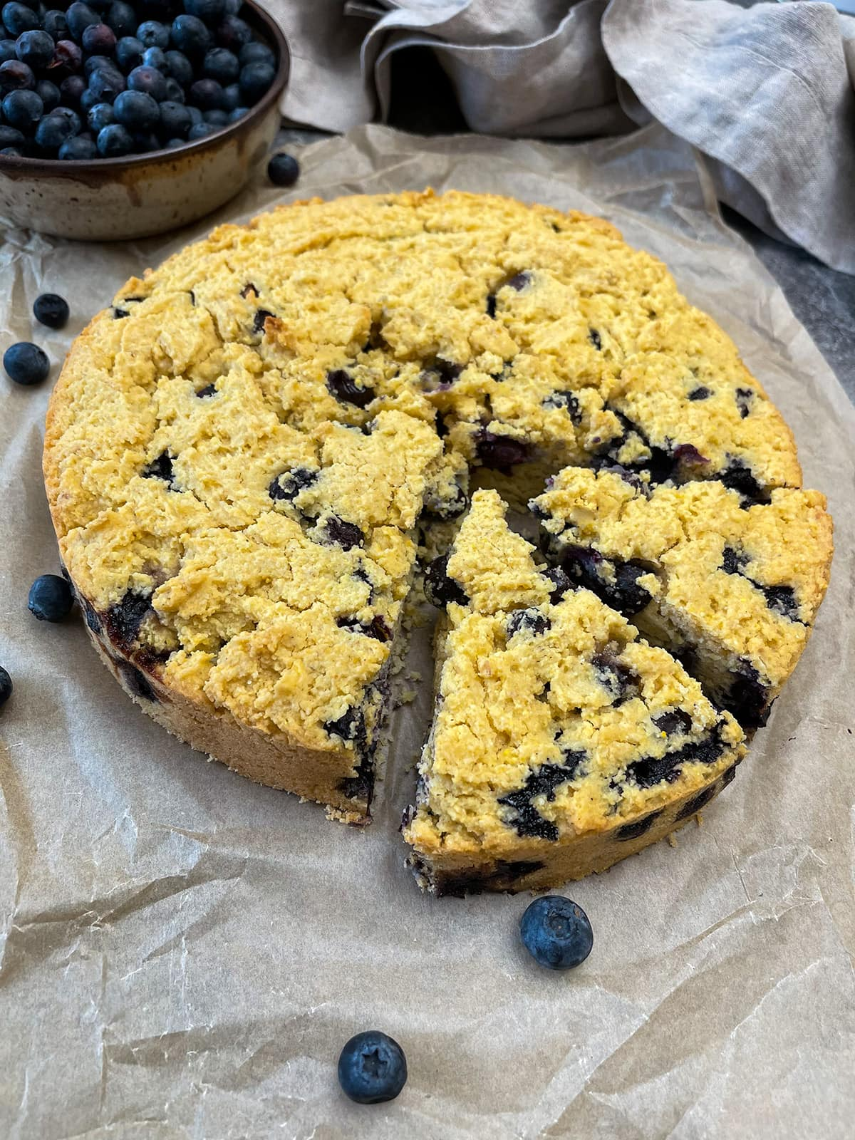 cornbread with blueberries on a beige parchment paper