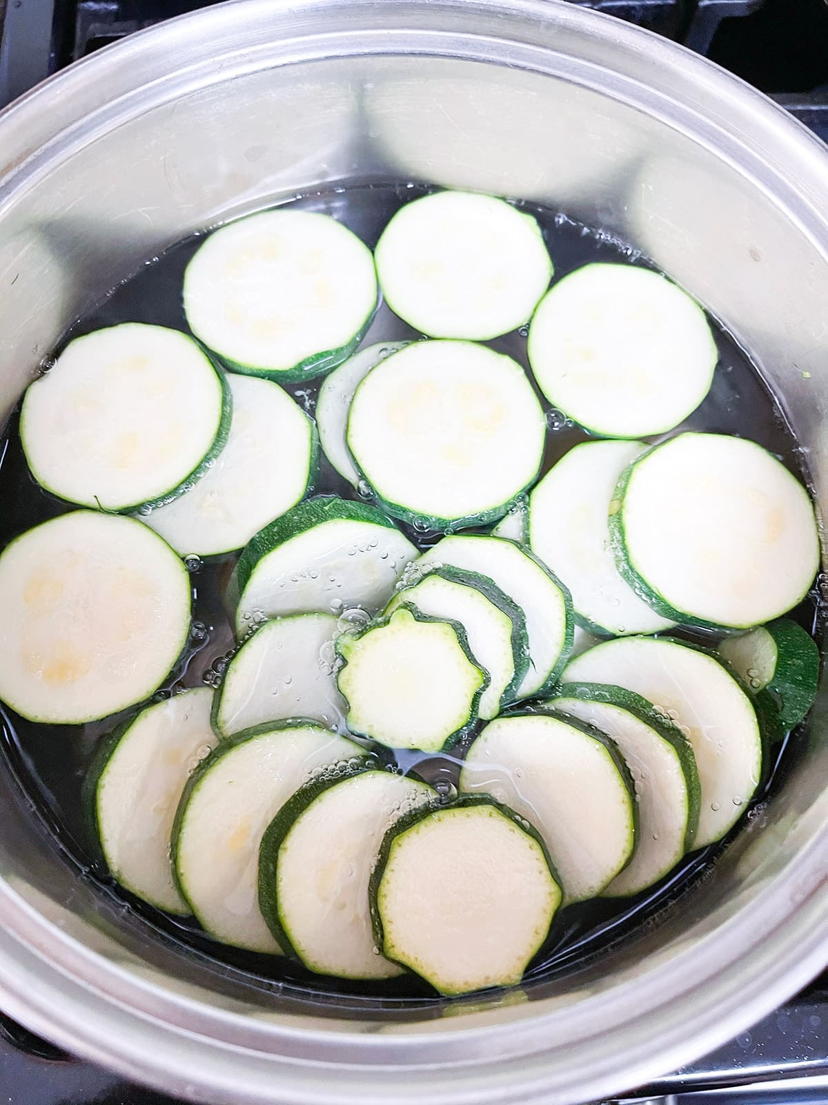 blanching zucchini slices in boiling water