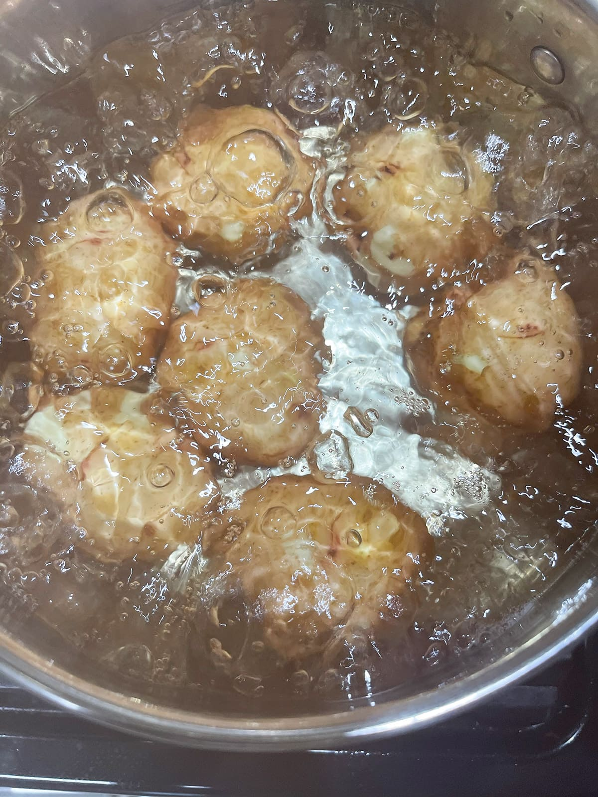 boiled potatoes in a pot of water